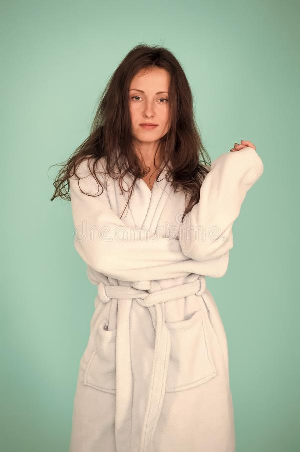 Spa and wellness concept. Girl no makeup face long hair wear bathrobe turquoise background. Ready for spa procedures. Woman relaxed after massage session or stock image