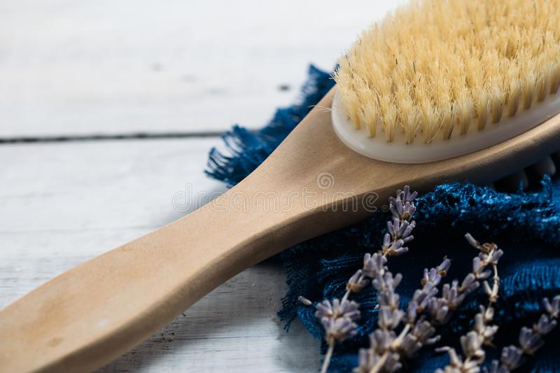 Spa wellness concept with lavender, essential oils and sea salt on wooden desk. Relaxation. Dry massage brush. stock photography