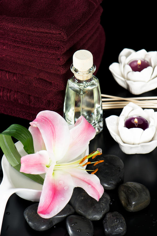 Spa and wellness concept. stones and towels. On black stock photos