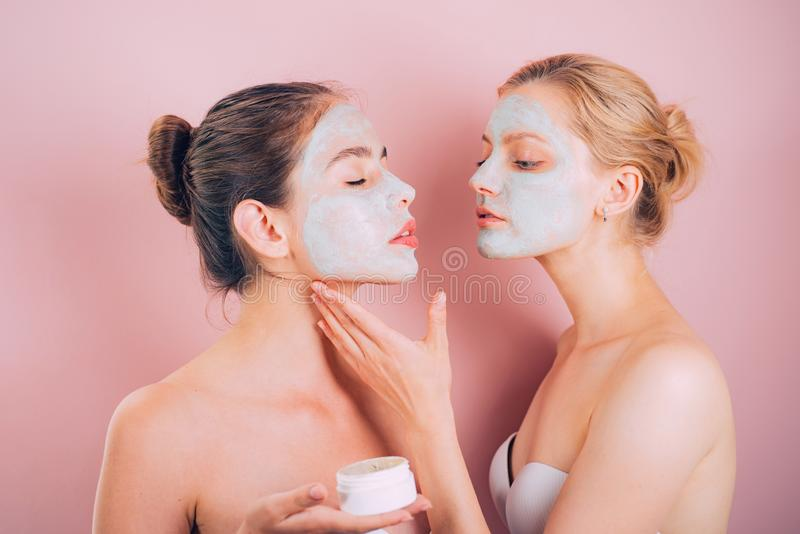 Spa and wellness. Girls friends sisters making clay facial mask. Anti age care. Stay beautiful. Skin care for all ages stock photo