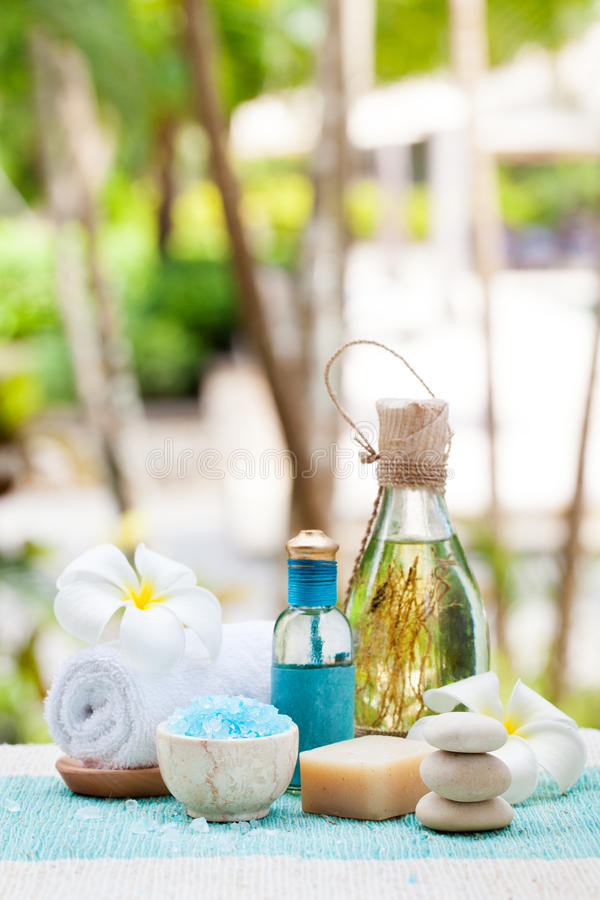 Spa and wellness massage setting Still life with essential oil, salt and stones Outdoor background Copy space royalty free stock images