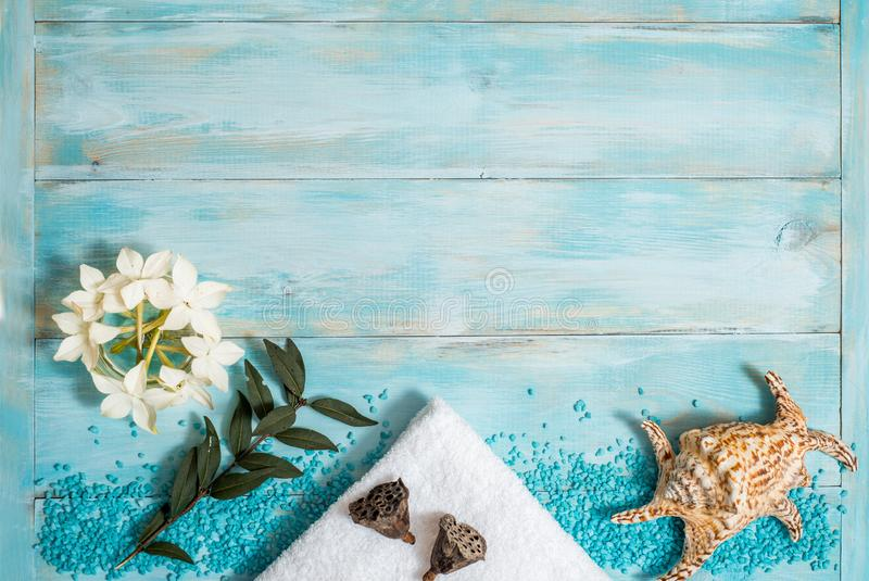 Spa and wellness setting with flowers, and white towel on old wooden background. Blue dayspa nature set. copyspace. Vacation. Concept. flat lay. top view stock images