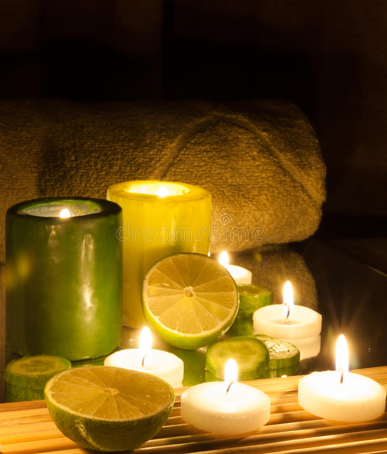 Spa and wellness setting green and yellow candles lit, lemon Green. Spa Concept green and yellow candles lit, lemon Green royalty free stock photography