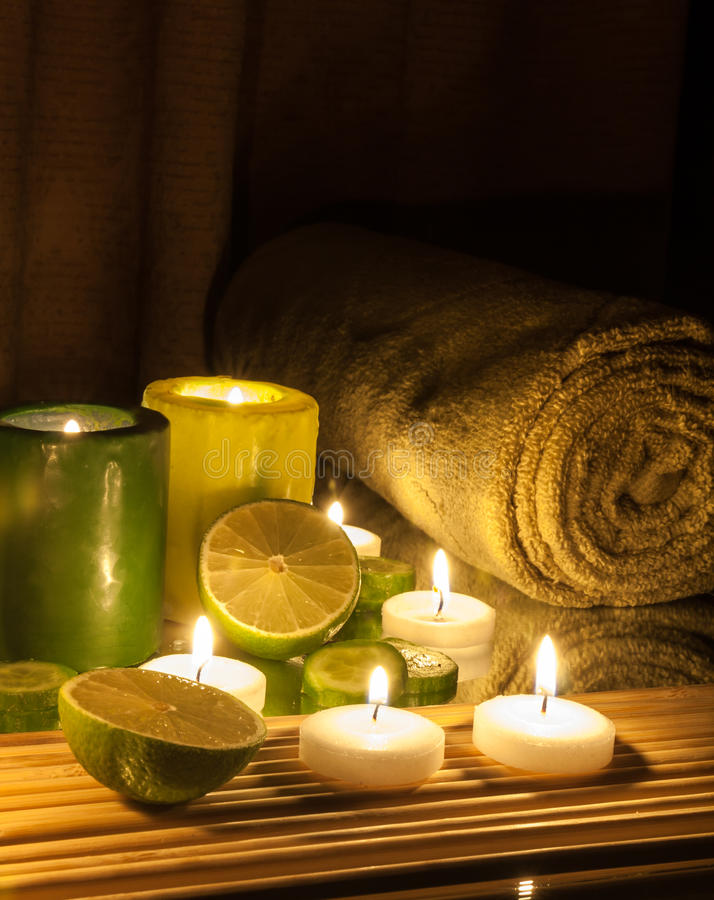 Spa and wellness setting green and yellow candles lit, lemon Green. Spa Concept green and yellow candles lit, lemon Green stock photo