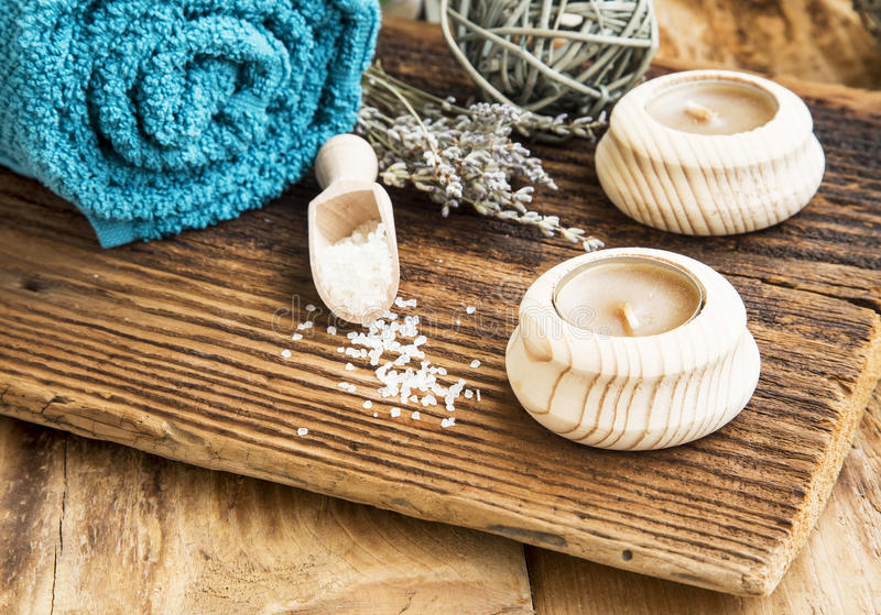 Spa and Wellness Setting on Wooden Background with Candles and L royalty free stock photography