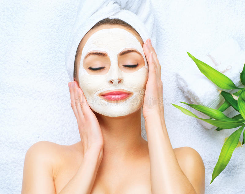 Spa woman applying cleansing mask. Spa woman applying facial cleansing mask stock photos