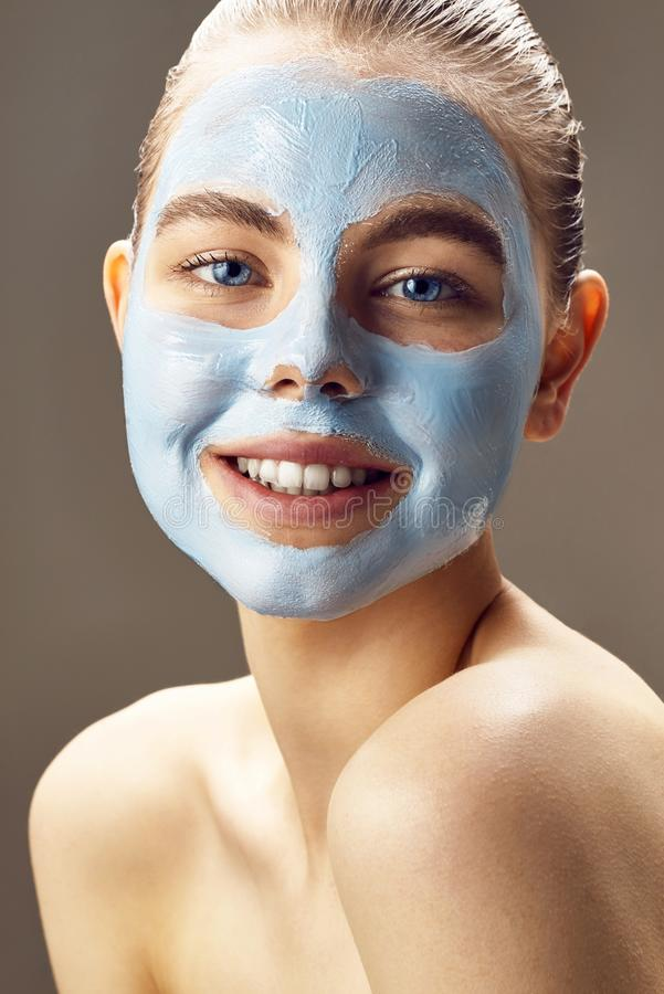Spa Woman applying mask for face and smiling. stock photography