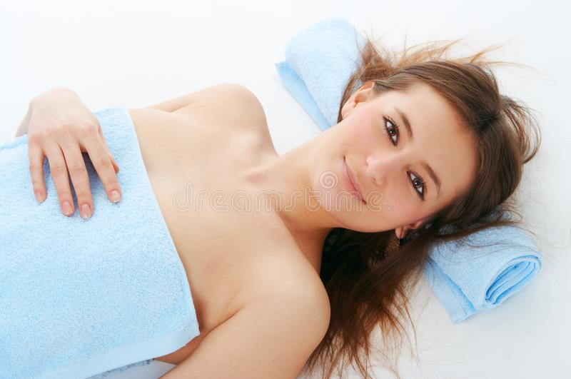 Spa woman in blue towel stock images