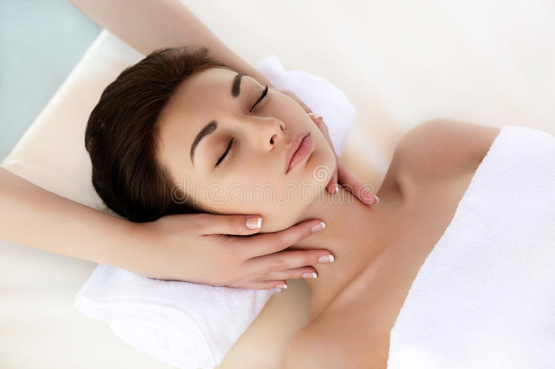 Spa Woman. Close-up of a young woman getting spa treatment. Face stock image