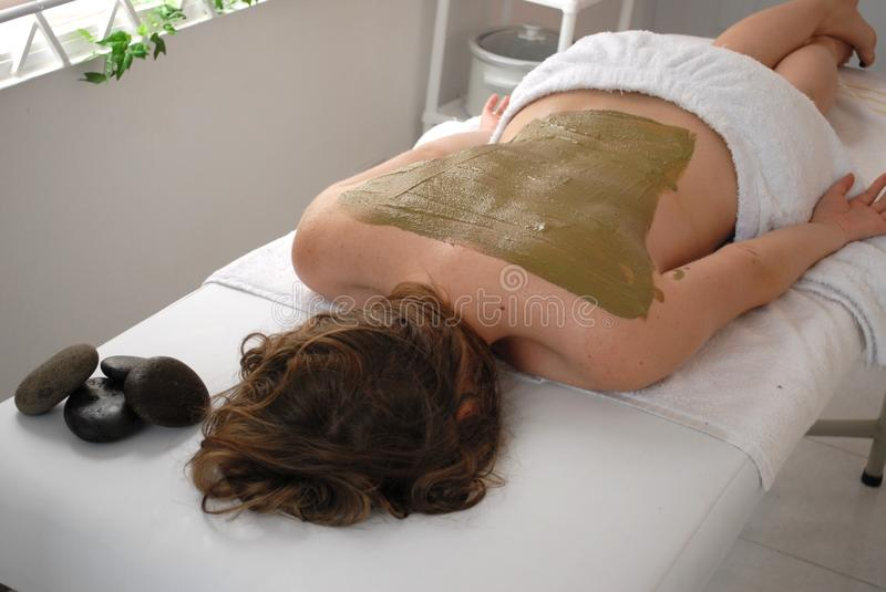 Spa woman mud on back royalty free stock photo