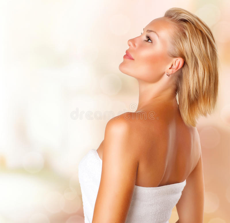 Spa Woman portrait. Beautiful Young Spa Woman portrait. Beauty Girl in Bath Towel royalty free stock photography