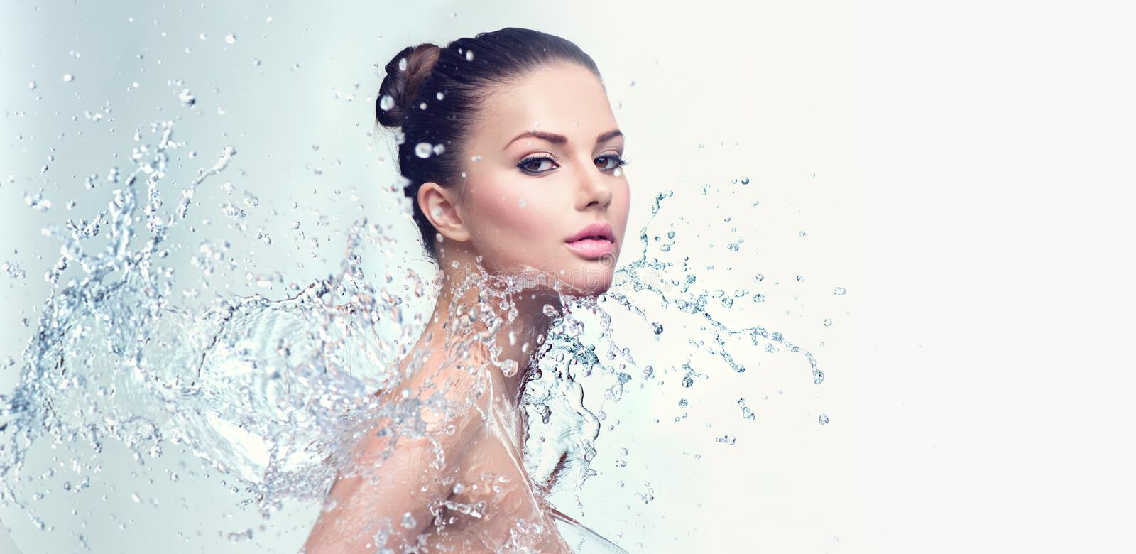 Spa woman with splashes of water. Beautiful spa woman with splashes of water stock photo