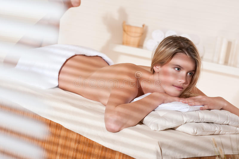 Spa - Young woman at wellness massage treatment. Spa - Young woman at wellness therapy treatment relaxing stock image