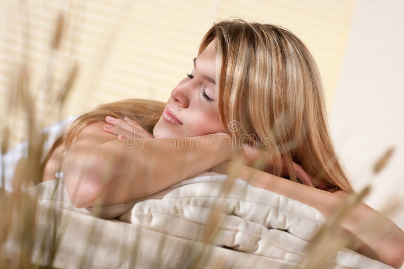 Spa - Young woman at wellness massage treatment. Therapy royalty free stock photography