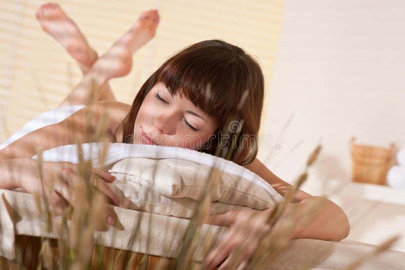 Spa - Young woman at wellness therapy. Waiting for massage royalty free stock photos