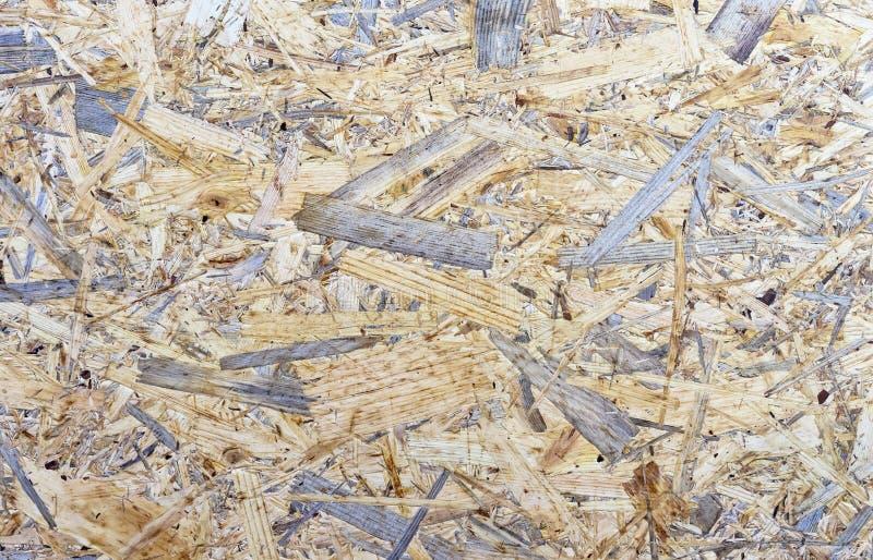 Spaanplaatachtergrond De ruwe Textuur van het Triplex Plaat van samengeperst zaagsel stock foto's