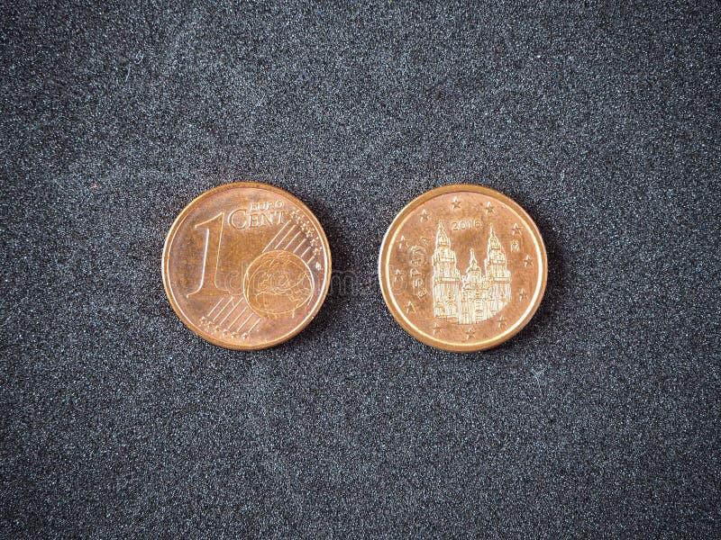 Spaanse euro muntstukhoofd en staart op de grijze achtergrond stock foto