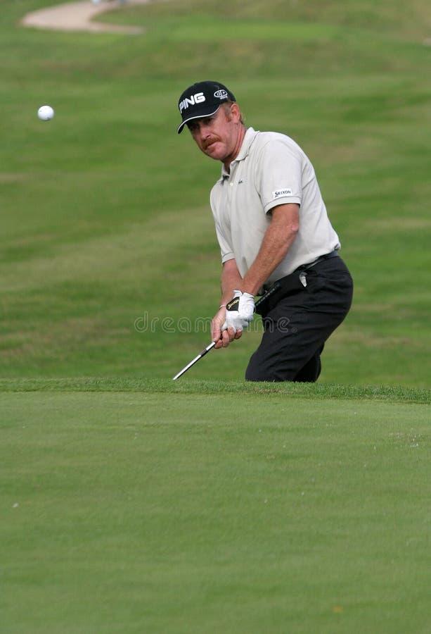 Spaanse golfspeler Miguel Angel Jimenez die de bal hitiing royalty-vrije stock foto