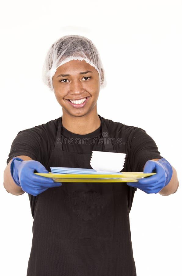 Spaanse jonge mens die blauwe schoonmakende handschoenen dragen royalty-vrije stock foto's