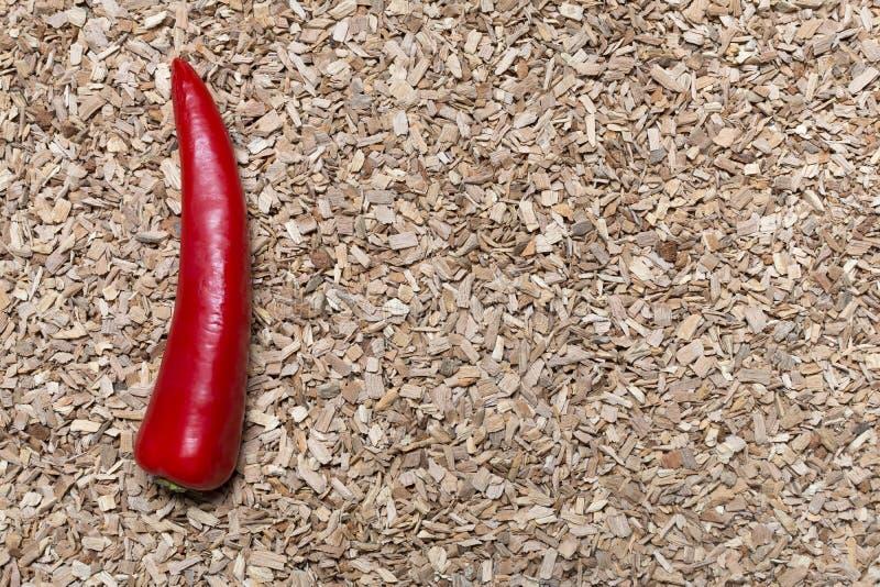 Spaanse peper op een zaagsel royalty-vrije stock afbeelding