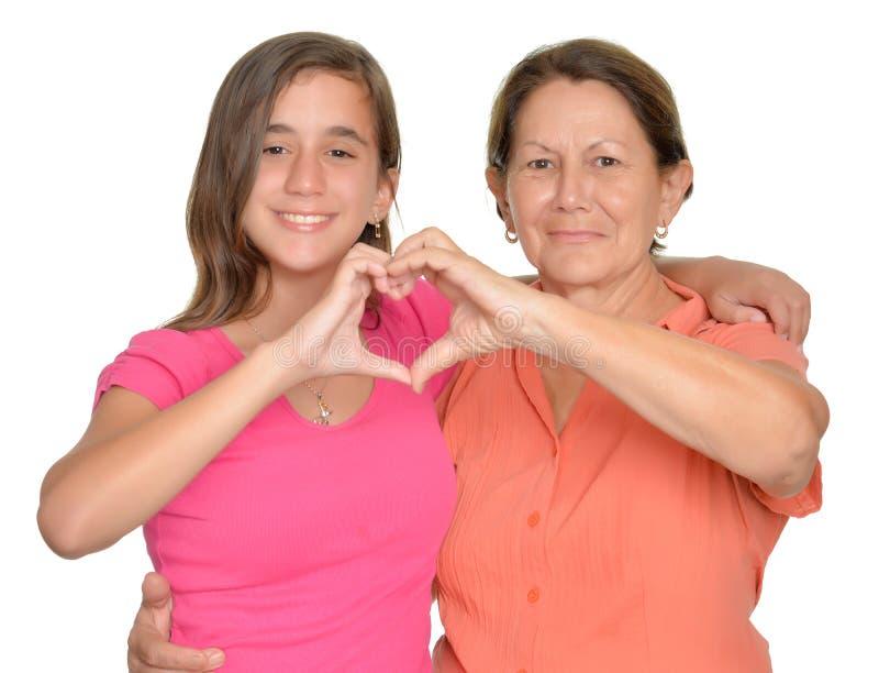 Spaanse tiener en haar grootmoeder stock afbeelding