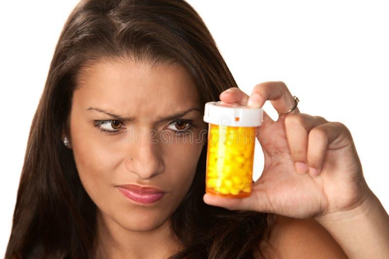 Spaanse vrouw met voorschriftmedicijn stock fotografie