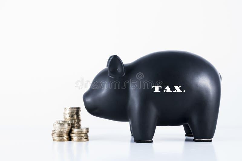 Spaarvarken - Belasting stock foto's