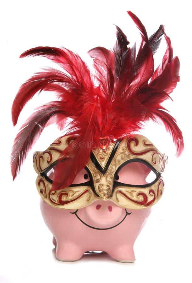 Spaarvarken dat het masker van de partijmaskerade draagt stock afbeelding