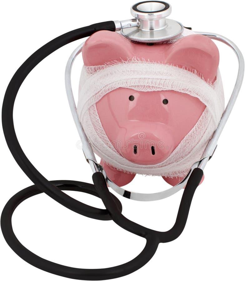 Spaarvarken in gaas met een stethoscoop wordt verpakt die - stock fotografie