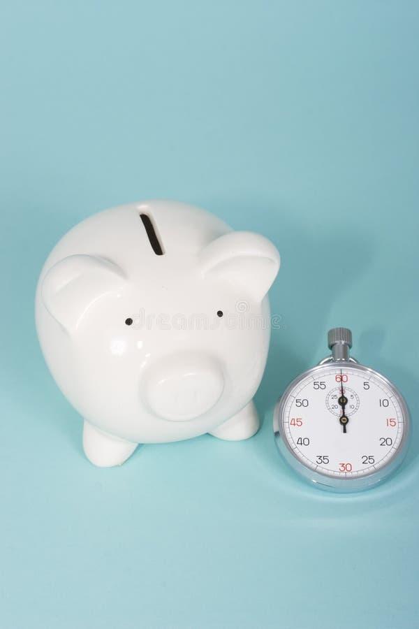 Spaarvarken met een chronometer stock afbeeldingen