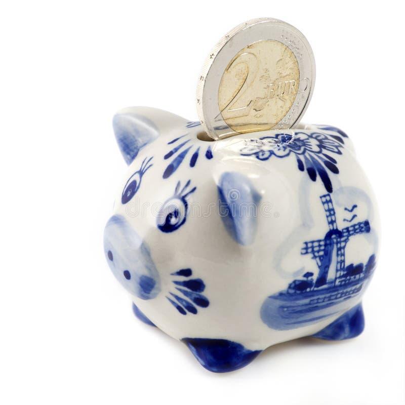 Spaarvarken met euro muntstuk royalty-vrije stock afbeelding