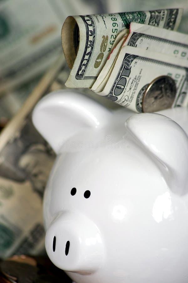 Spaarvarken met geld stock fotografie