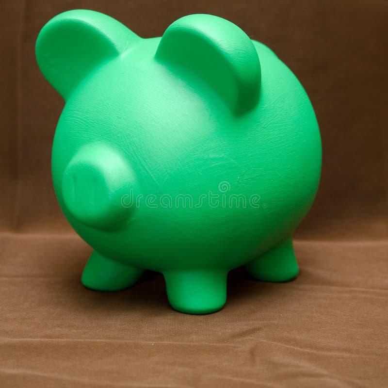 Spaarvarken op Bruin stock afbeeldingen