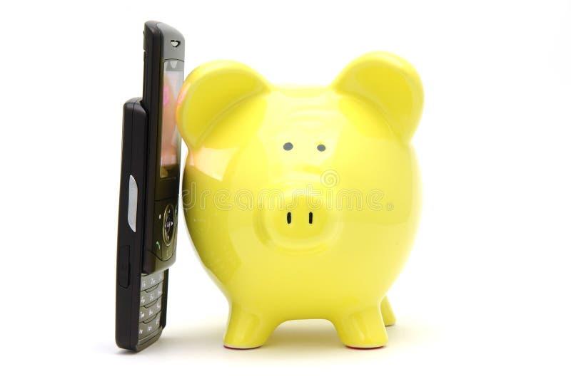 Spaarvarken op telefoon royalty-vrije stock afbeeldingen