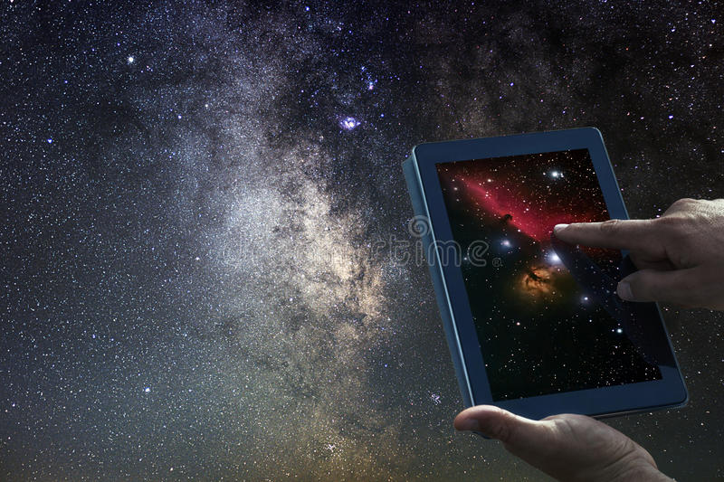 Space Astronomy Exploration Concept. Night Sky tablet Milky Way. Galaxy. Space Astronomy Exploration Concept. Saturn planet tablet stock photos