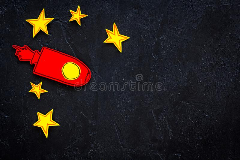 Space flight or space travel concept. Drawn stars and rocket or space shuttle on black background top view copy space royalty free stock photos
