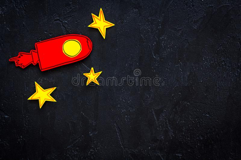 Space flight or space travel concept. Drawn stars and rocket or space shuttle on black background top view copy space royalty free stock photography