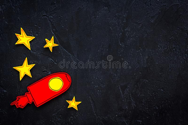 Space flight or space travel concept. Drawn stars and rocket or space shuttle on black background top view copy space stock photography