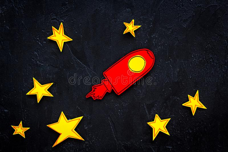 Space flight or space travel concept. Drawn stars and rocket or space shuttle on black background top view royalty free stock photo