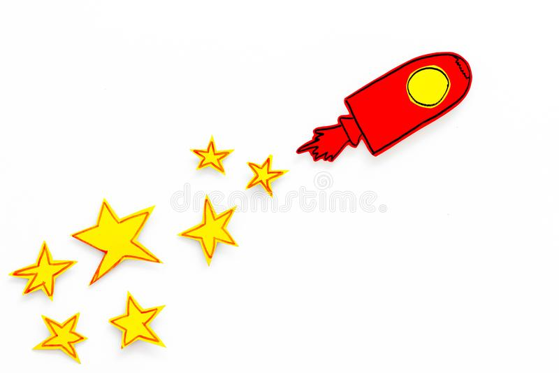 Space flight or space travel concept. Drawn stars and rocket or space shuttle on white background top view copy space royalty free stock images