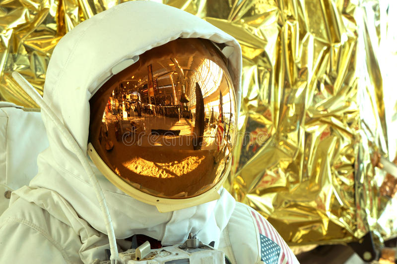 Space reflections. This extravehicular activity (EVA) suit and moon lander is on display at the Evergreen Aviation Museum in McMinnville, Oregon. The helmet and royalty free stock photo