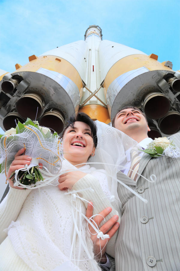 Free Space Rocket Over Fiance And Bride Royalty Free Stock Photos - 10699108