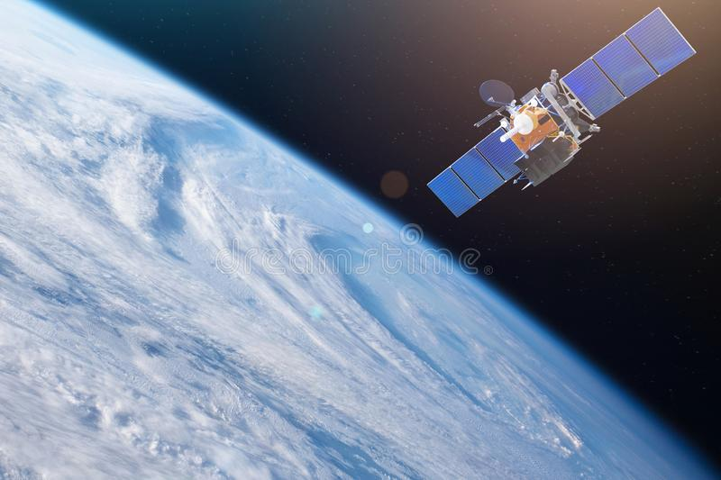 Space satellite orbiting the earth. Elements of this image furnished by NASA.  royalty free stock photo
