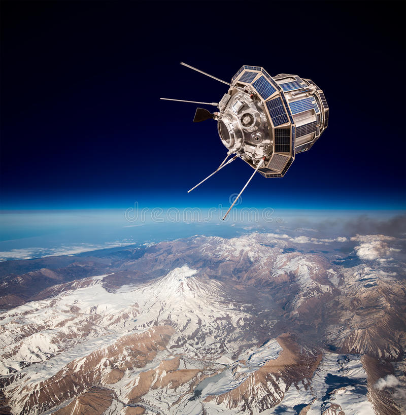 Space satellite over the planet earth. Space satellite orbiting the earth royalty free stock photo