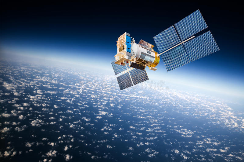 Space satellite over the planet earth. Space satellite orbiting the earth stock photography