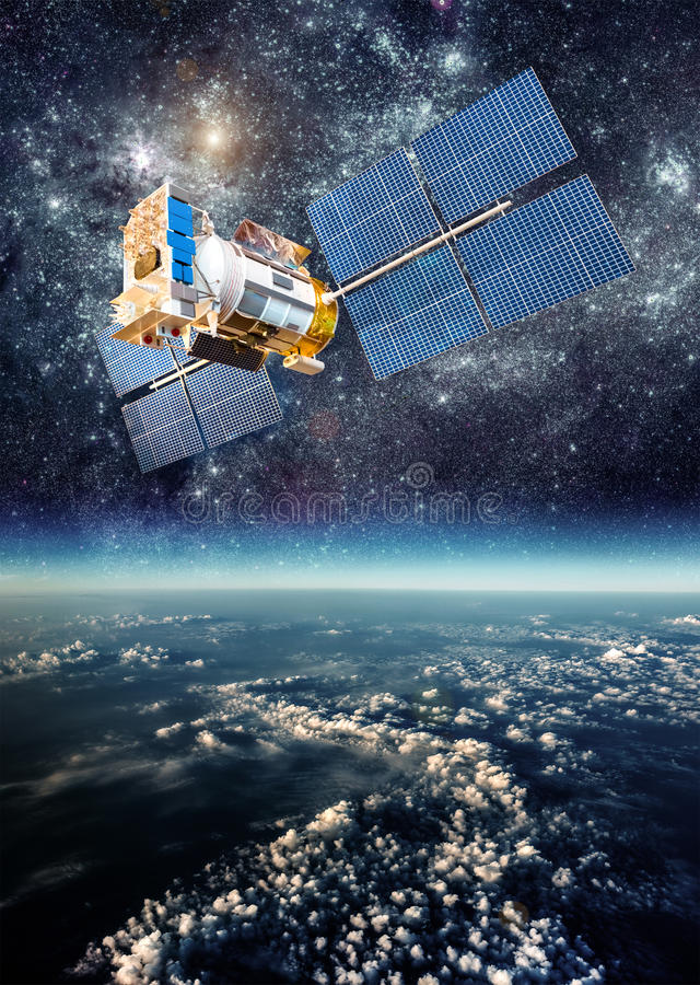 Space satellite over the planet earth. Space satellite orbiting the earth. Elements of this image furnished by NASA stock image