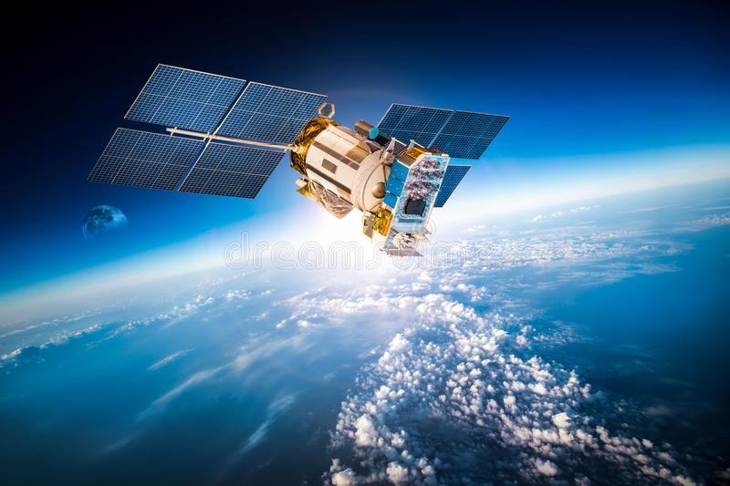 Space satellite over the planet earth royalty free stock photos