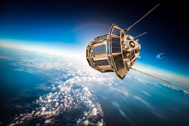 Space satellite over the planet earth. Space satellite orbiting the earth. Elements of this image furnished by NASA stock images