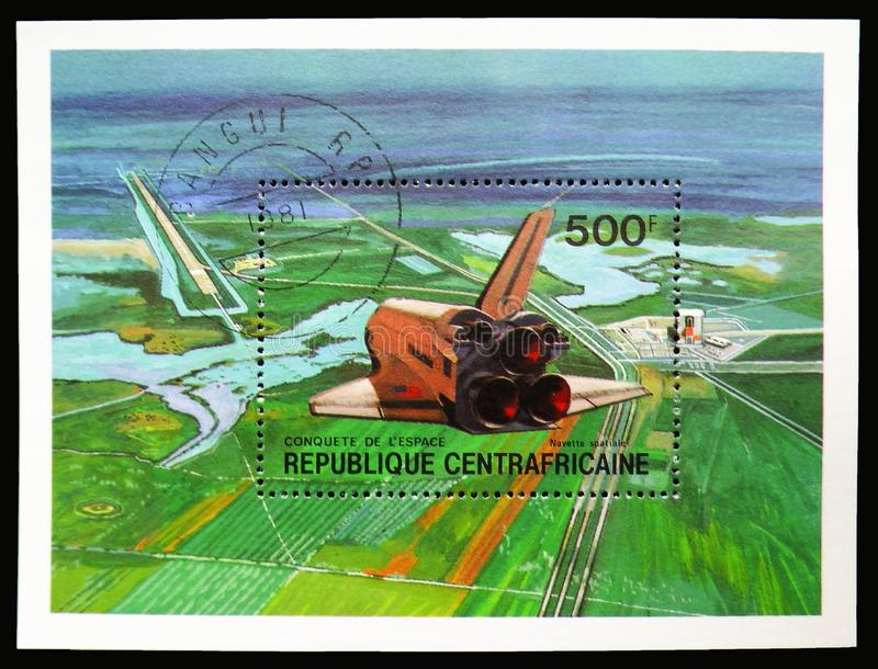 Space shuttle, landing, Conquest of the Space serie, circa 1981. MOSCOW, RUSSIA - SEPTEMBER 15, 2018: Joint issue stamp printed in Central African Republic shows royalty free stock photography