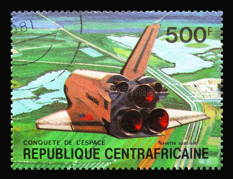 Space shuttle, landing, Conquest of the Space serie, circa 1981. MOSCOW, RUSSIA - SEPTEMBER 15, 2018: A stamp printed in Central African Republic shows Space royalty free stock photo